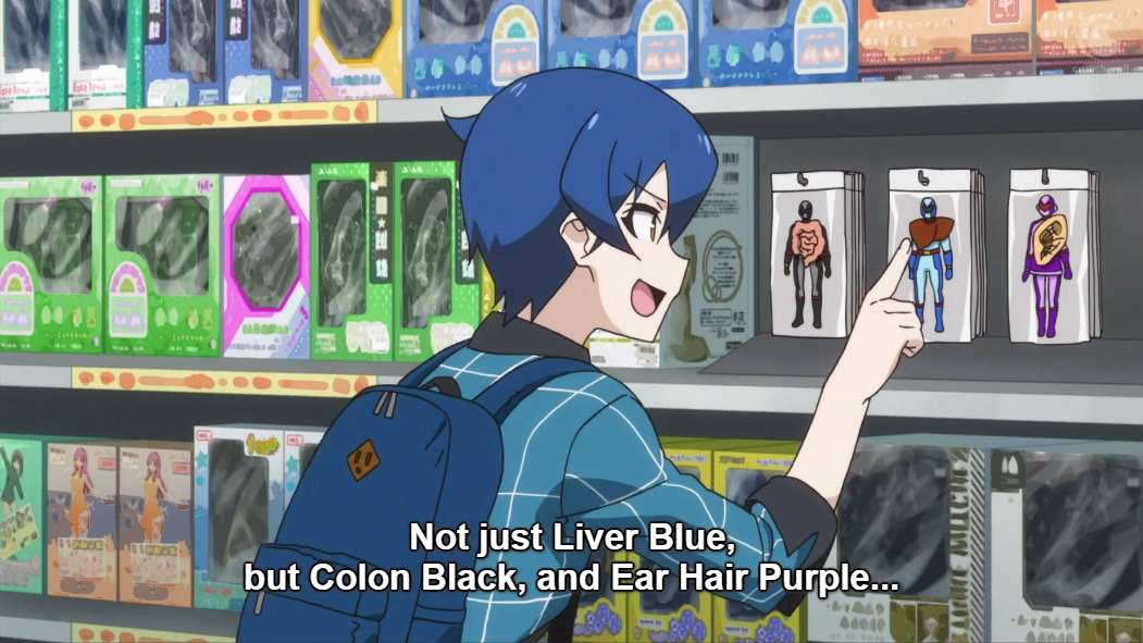 """Tamotsu looks in excitement at figurines in packets in a figurine shop. He is pointing to three, all human shaped in colourful costumes and masks with some kind of organ attached to them. Subtitle """"Not just Liver Blue, but Colon Black, and Ear Hair Purple..."""""""