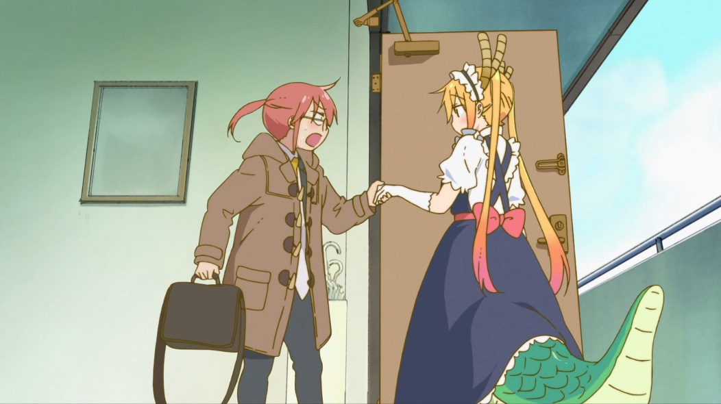 Kobayashi stands at the front door of her apartment in trousers, a shirt and tie and a duffel coat, holding a laptop bag. She holds the hand of Tohru, who looks shy with long blonde hair and a frilly maid's outfit with a full-length skirt and a dragon tail protruding from under it.