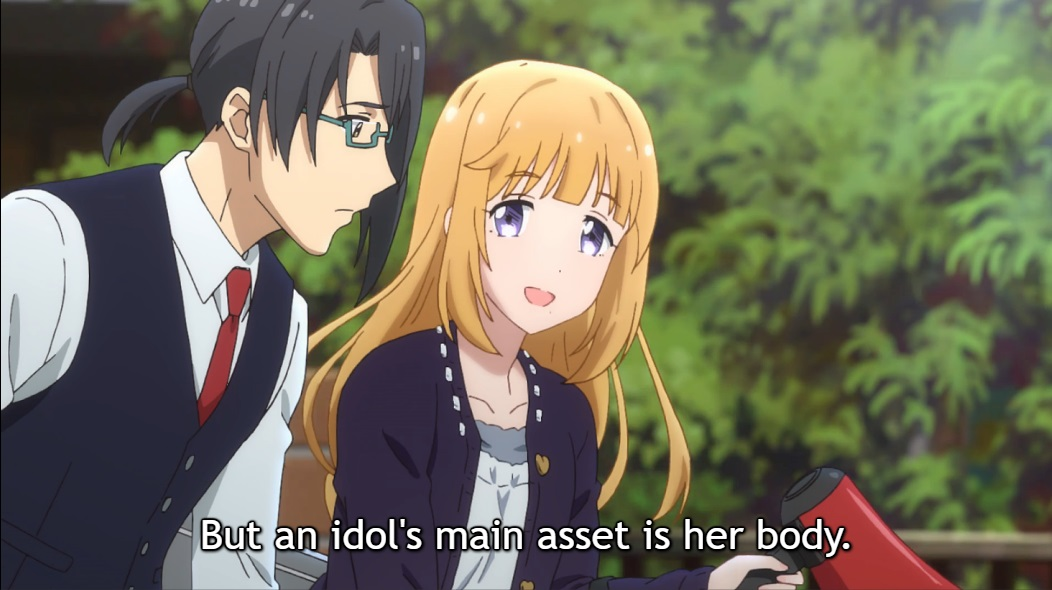 "Sachie, with long blonde hair and blue eyes, smiles as she speaks to her worried assistant, a man in a white shirt, waistcoat, red tie and glasses, dark hair in a ponytail. Subtitle: ""But an idol's main asset is her body."""
