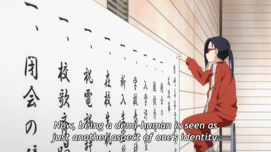 "Satou-sensei sits on a stool in her gym clothes, pinning a sign to the wall. Subtitle: ""Now, being a demi-human is seen as just another aspect of one's identity."""