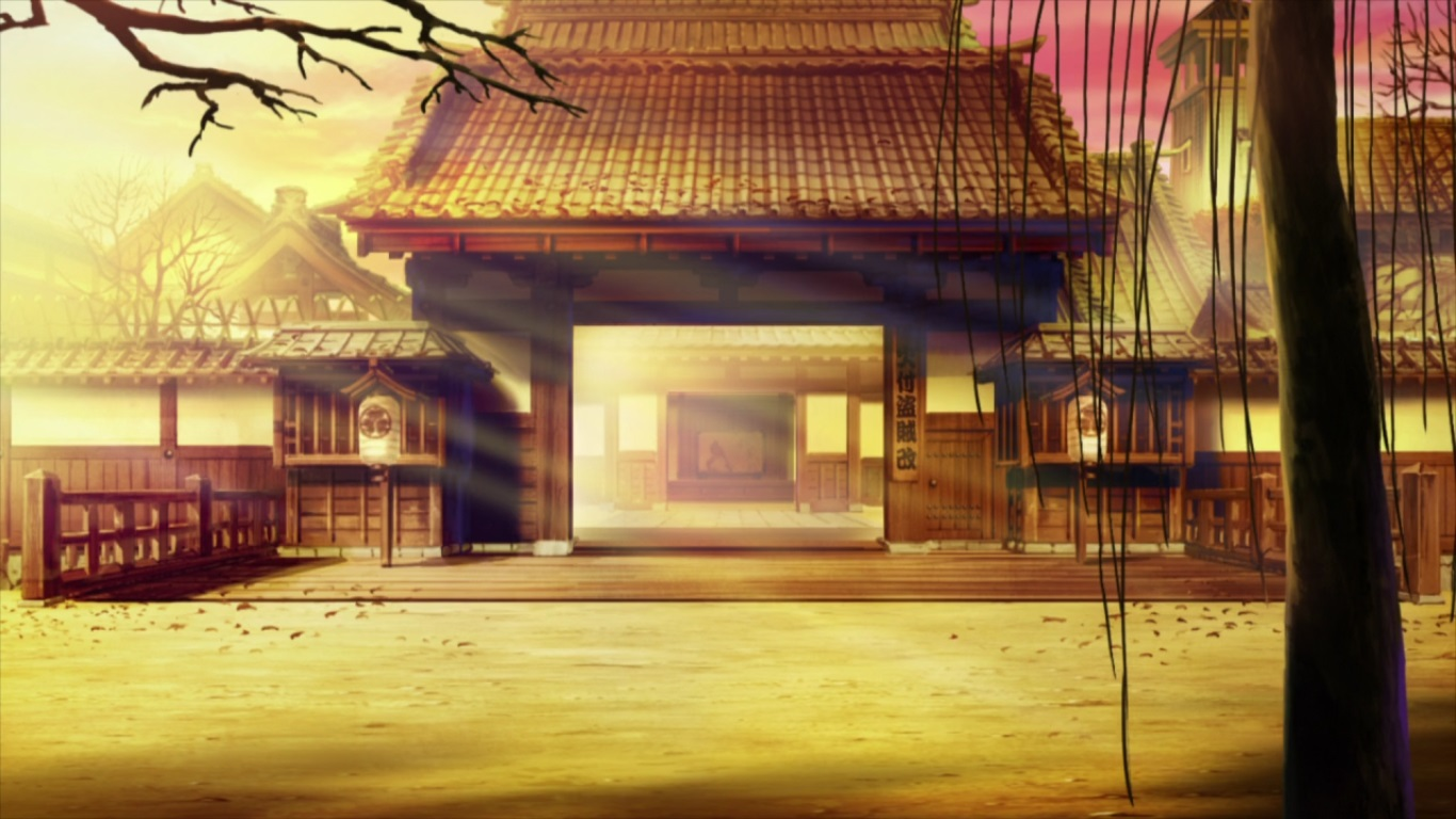 A beautiful image of the entrance to a Japanese building, with other buildings behind it and bare winter trees in front.