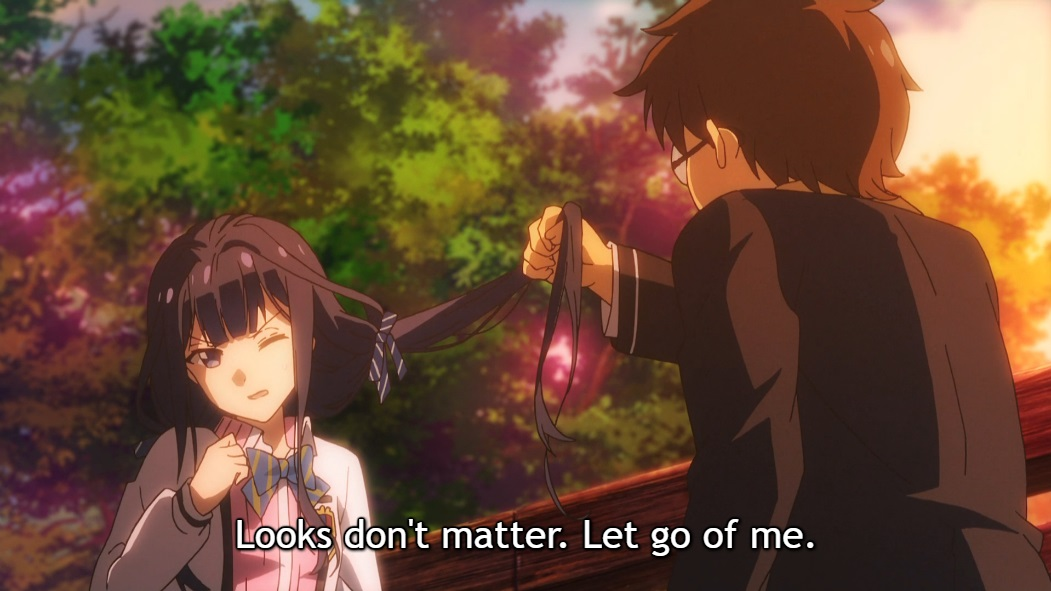 "A male classmate with glasses pulls on Aki's long hair as she winces. Subtitle: ""Looks don't matter. Let go of me."""
