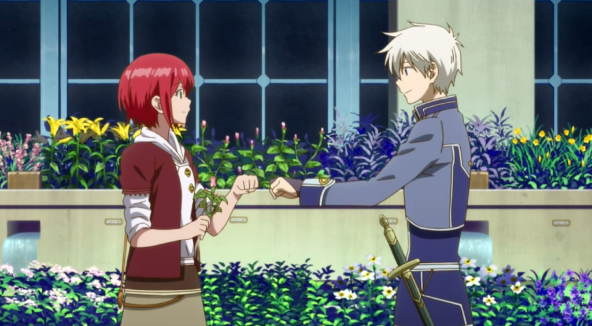 Shirayuki, a young woman with red hair, stands in a greenhouse holding a flower and smiling at Zen, a young man with silver hair who is wearing a military uniform and offers her a supportive fist-bump.