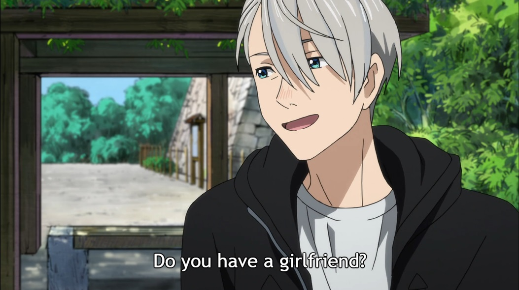 "Victor sits on a bench outside in Hasetsu, smiling as he talks to Yuri, who is off screen. Subtitle: ""Do you have a girlfriend?"""