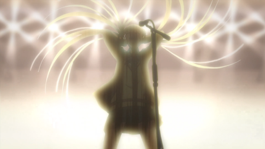 Alice is backlit on stage in front of a microphone, holding her head as she flings her hair back in a dramatic arc and sings as loud as she can.