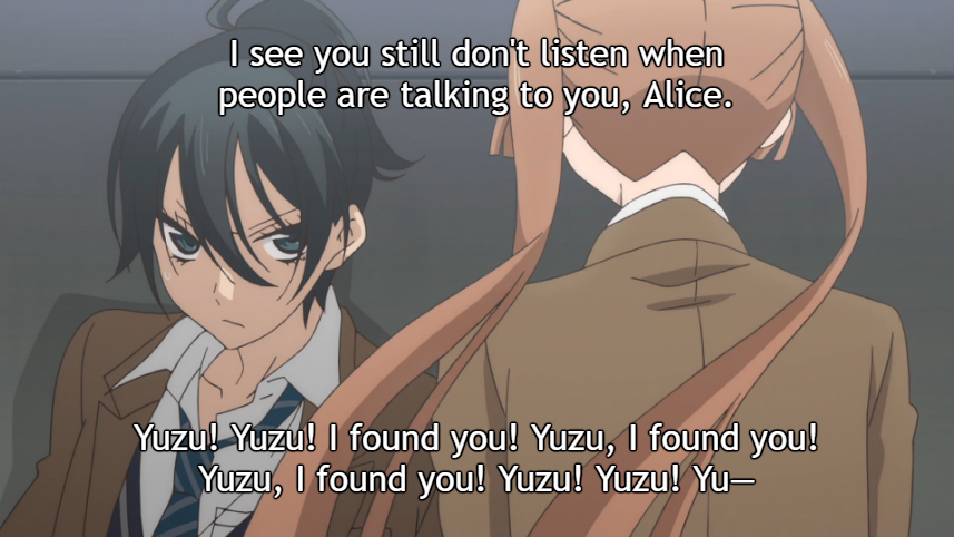 "Alice babbles at a guarded Yuzu as he leans against the wall where she knocked him down with a hug. Yuzu's subtitle: ""I see you still don't listen when people are talking to you, Alice."" Alice's subtitle: ""Yuzu! Yuzu! I found you! Yuzu, I found you! Yuzu, I found you! Yuzu! Yuzu! Yu-"""