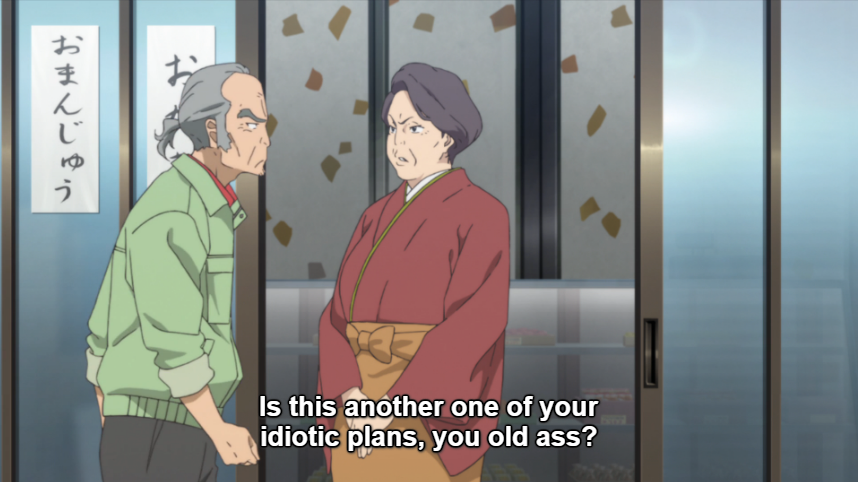 "An older woman in traditional Japanese clothing stands at the entrance of a Japanese sweet shop, looking stern as the grumpy Mr. Kadota walks past. Subtitle: ""Is this another one of your idiotic plans, you old ass?"""