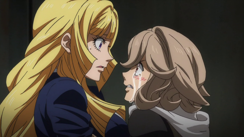 A close-up of a a long-haired woman in a jacket, looking surprised, faces a curly-haired young woman who has angry tears streaming down her cheeks