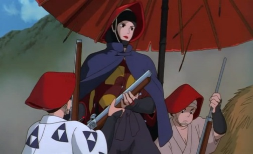 A woman in a red hat and dark cloak stands beneath an umbrell, holding a rifle, with two men in matching hats beside her
