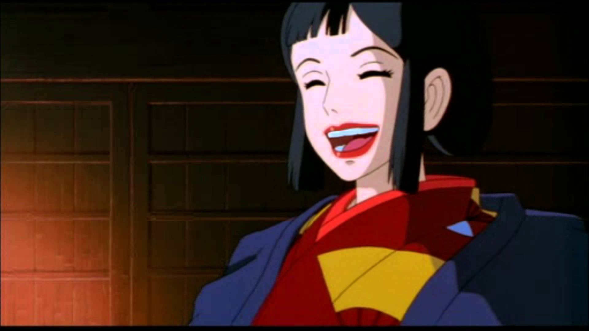 A dark-haired woman in traditional Japanese clothing laughs