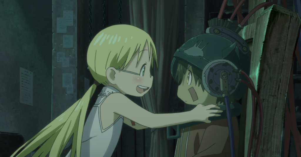 A blonde girl with pigtails puts her hand on the shoulders of a robot-boy wearing a helmet