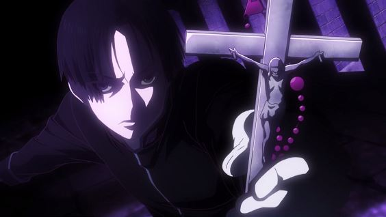 Hiraga holds out a crucifix toward the camera