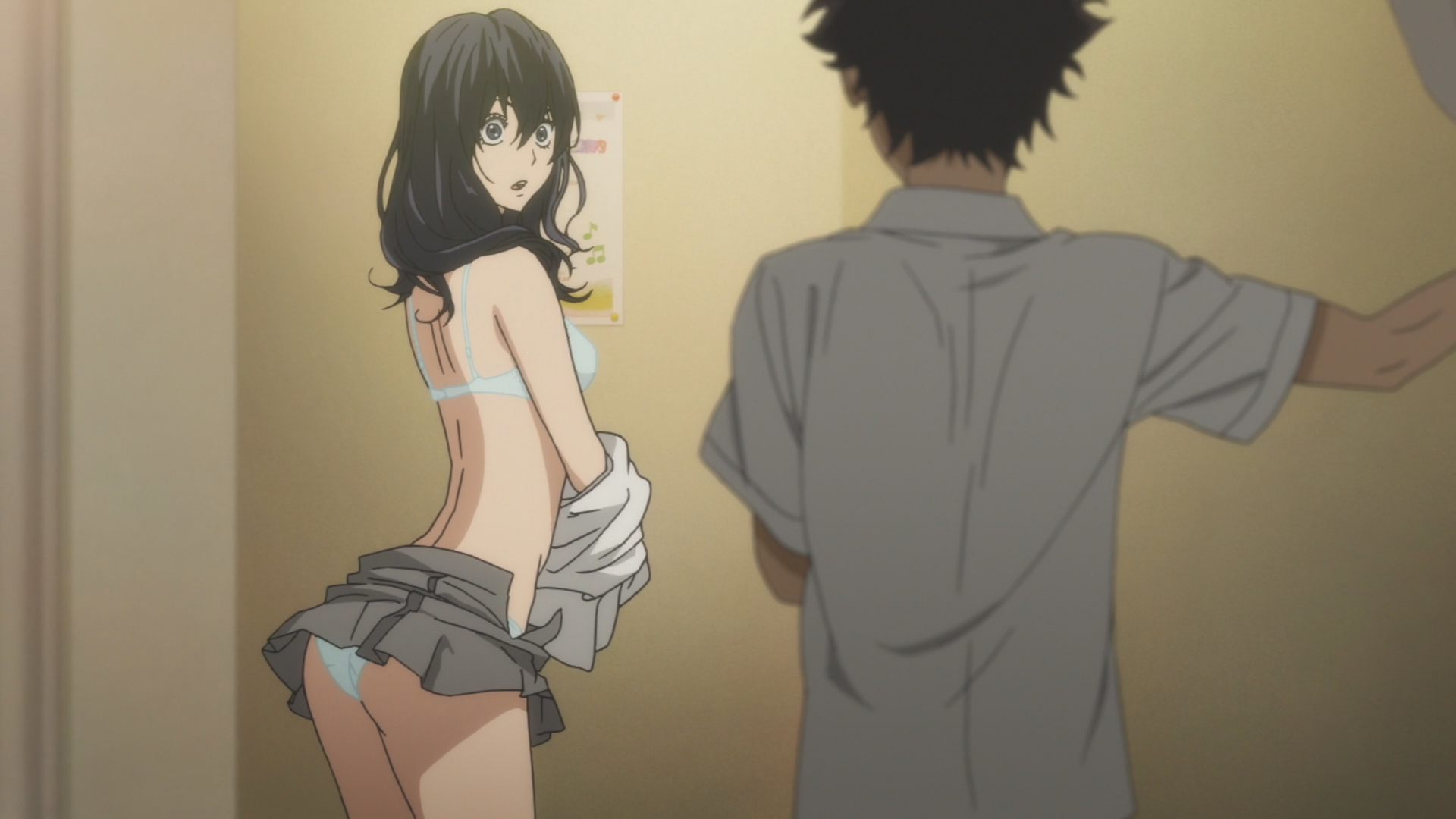 the camera is behind a young man's back as he looks at a girl changing. She is halfway through taking her shirt off, and her underwear is visible under her skirt