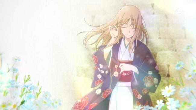 A long-haired girl in a kimono stands against a brick wall, eyes closed, with blue flowers surrounding her