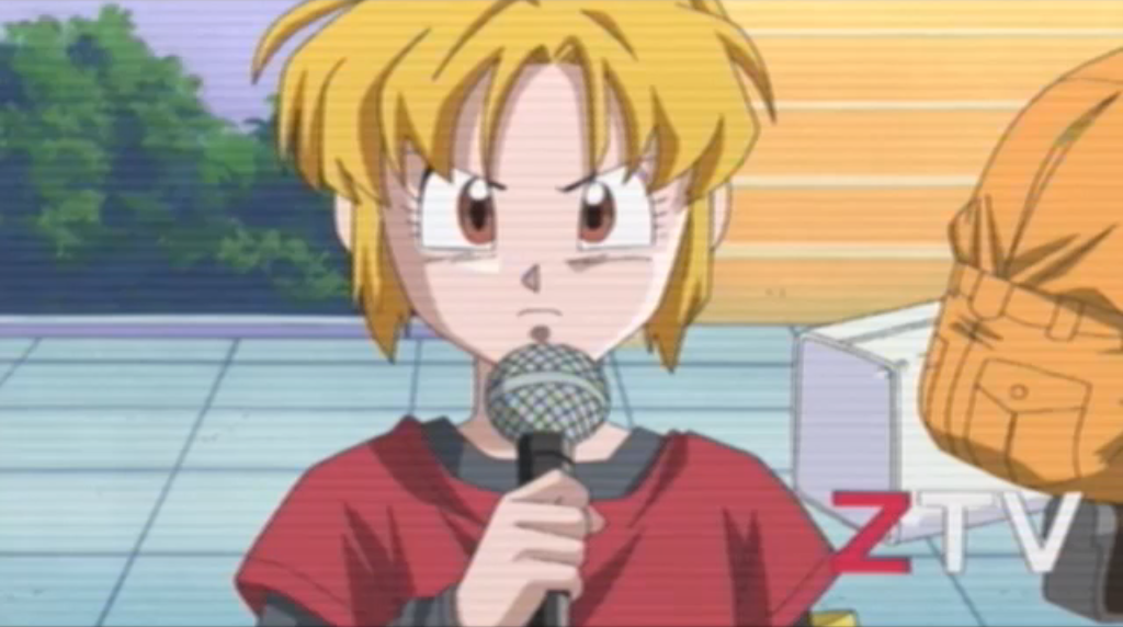 "A blonde woman on a TV screen marked ""ZTV"" holds a microphone and looks serious"