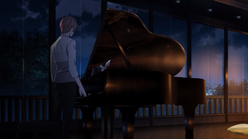 A man with his back to the camera faces a grand piano in a darkened room. There appears to be a white stuffed bunny atop the piano, but it's in shadow and hard to see.