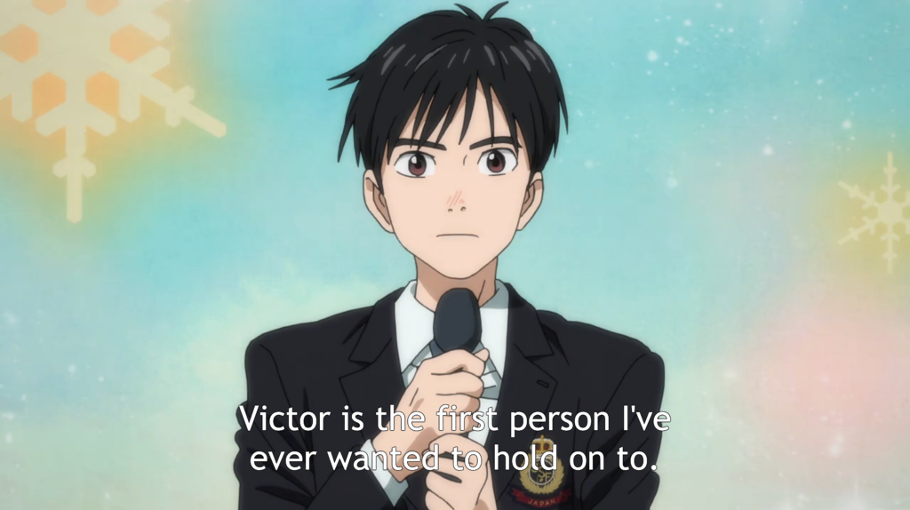 Yuri, dressed in a suit and holding a microphone. caption: Victor is the first person I've ever wanted to hold on to