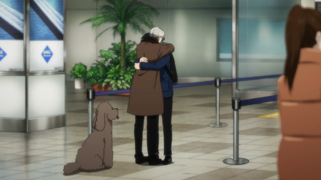 Victor and Yuri embracing at the airport