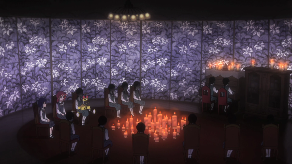A group shot of faceless girls playing piano. The background is stained glass patterned with lilies and the only light comes from candles