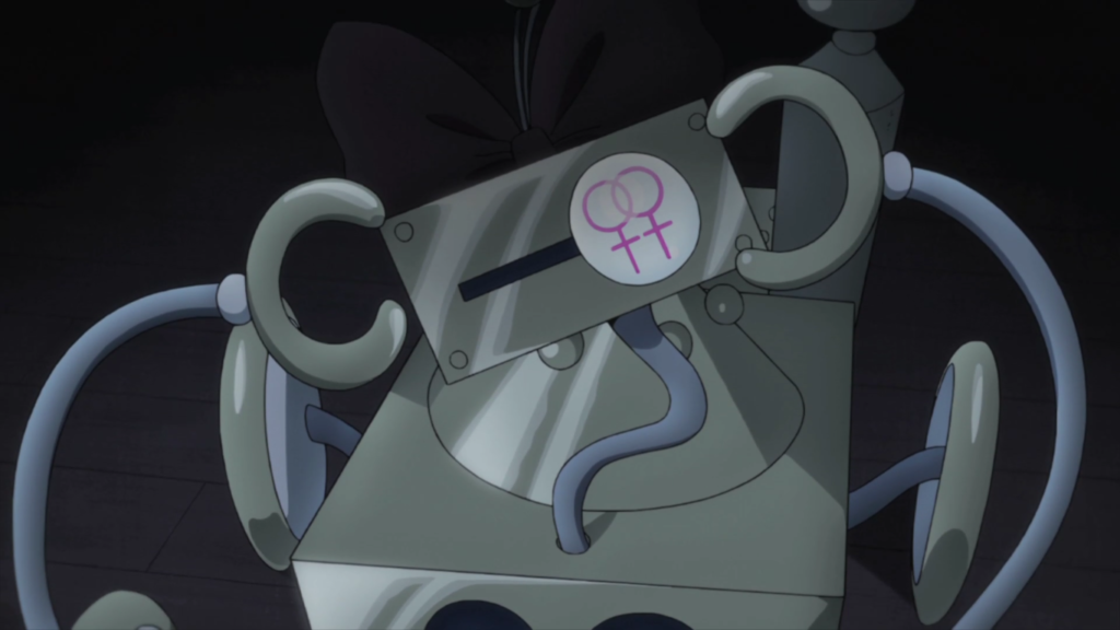 The robot Bu-chan, recently hypnotised, wearing a bow on its head and with two interlocking 'female' symbols in his display screen