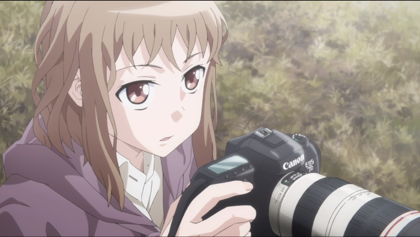 A girl with short, messy hair stares intently, holding a high-speed camera