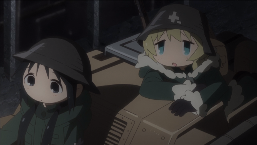 two girls in a military jeep, wearing coats and helmets