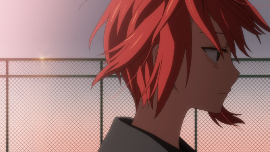 A girl with a grimly blank expression stands in profile, with a fence behind her. It appears to be sunset or sunrise. A breeze ruffles her hair.