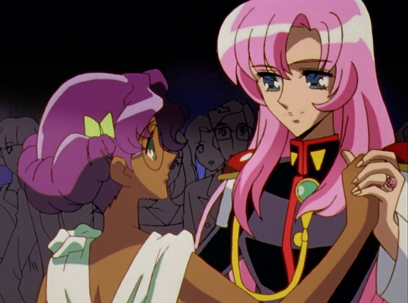 A chest up shot of two girls dancing (Utena and Anthy). The camera is over Anthy's shoulder; Utena is smiling and taking lead