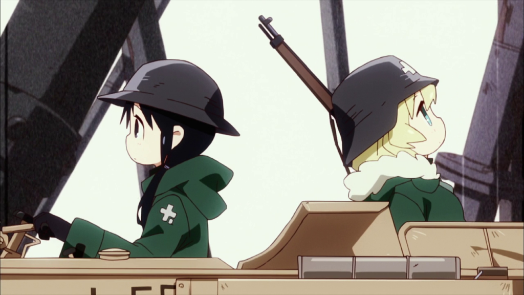 Two girls wearing military helmets and coats sit in a vehicle. The girl with pigtails faces forward and has her hands on the steering wheel. The girl with long unbound hair carries a rifle casually over one shoulder and sits facing backwards, looking up as if lost in thought.