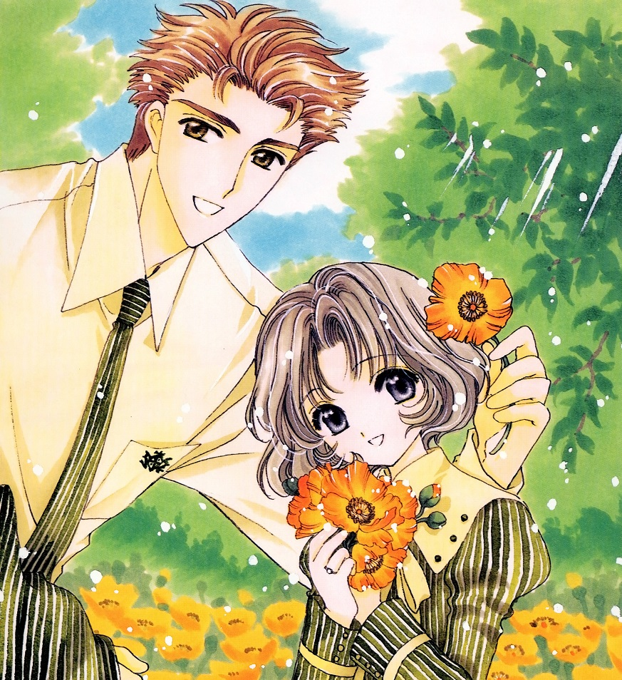 An adult man in shirt and necktie poses with a girl in a field of flowers. He's setting one flower behind her ear.