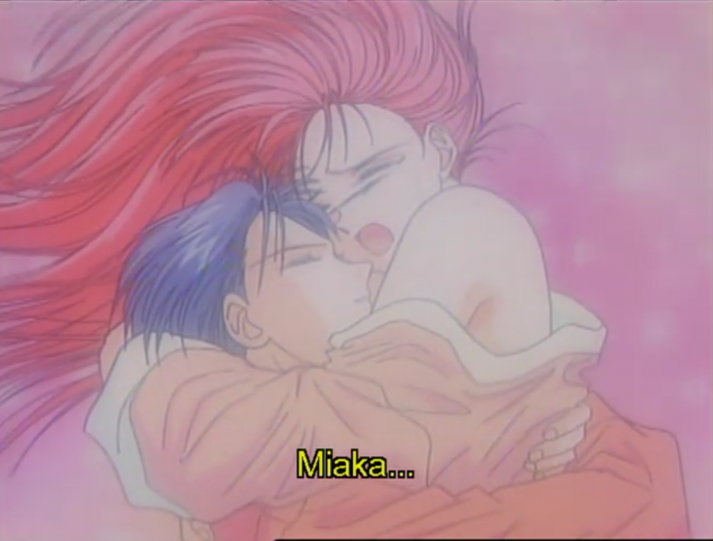 """A pastel image of a teen girl (Miaka), her shoulders bare, as she throws her arm around a teen boy (Taka) and sobs. Subtitles: """"Miaka..."""""""