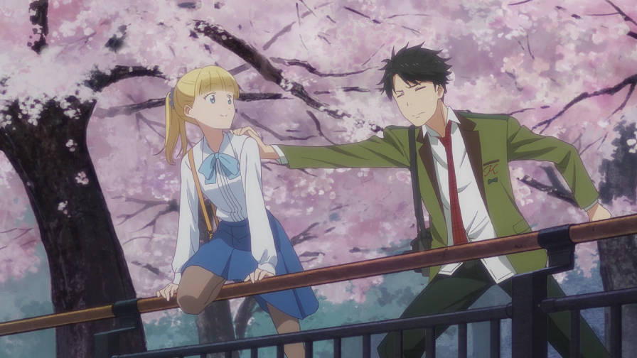 A teen boy in a school uniform puts his hand on a blonde girl's shoulder as she makes to climb a railing. There are cherry trees behind them.