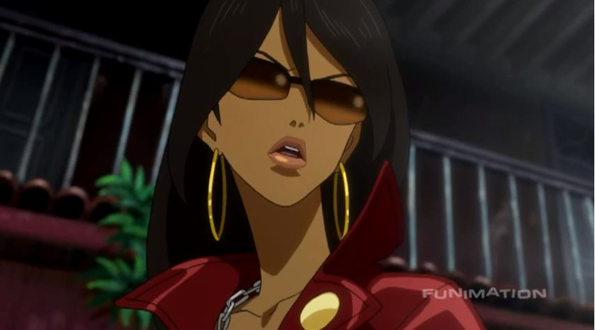 Close-up of Michiko wearing sunglasses and looking intimidating