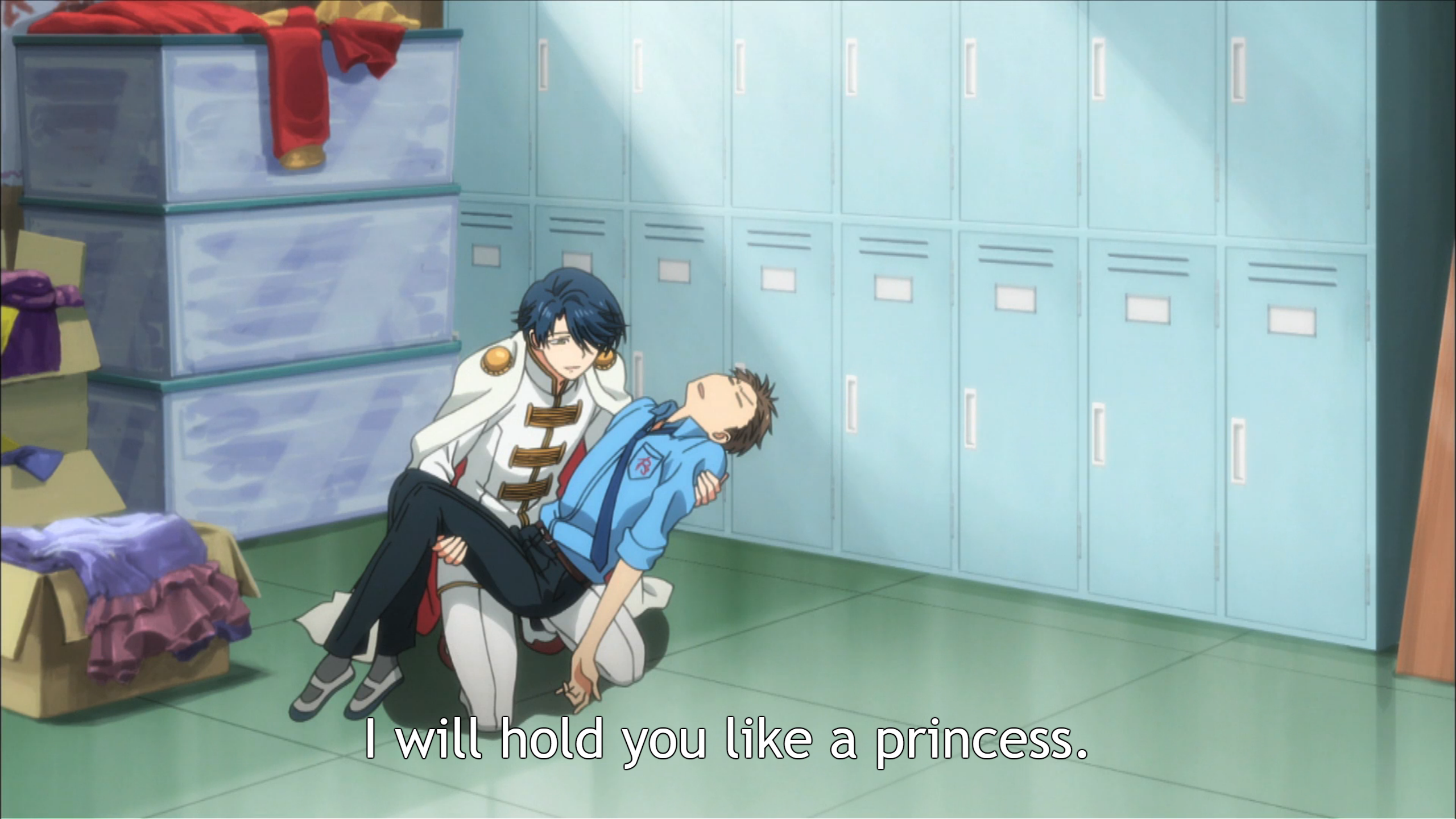 "A girl dressed in prince's clothing kneels down with an unconscious boy in a school uniform in her arms. Subtitles read: ""I will carry you like a princess."""