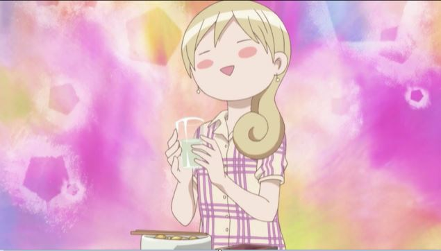 Wakako holding a glass and looking blissful