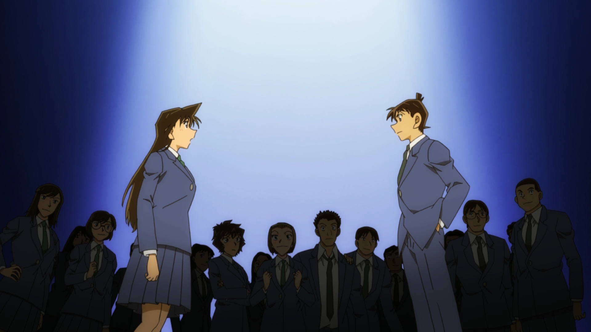 Ran and Shinichi faceoff while their classmates look on in the background