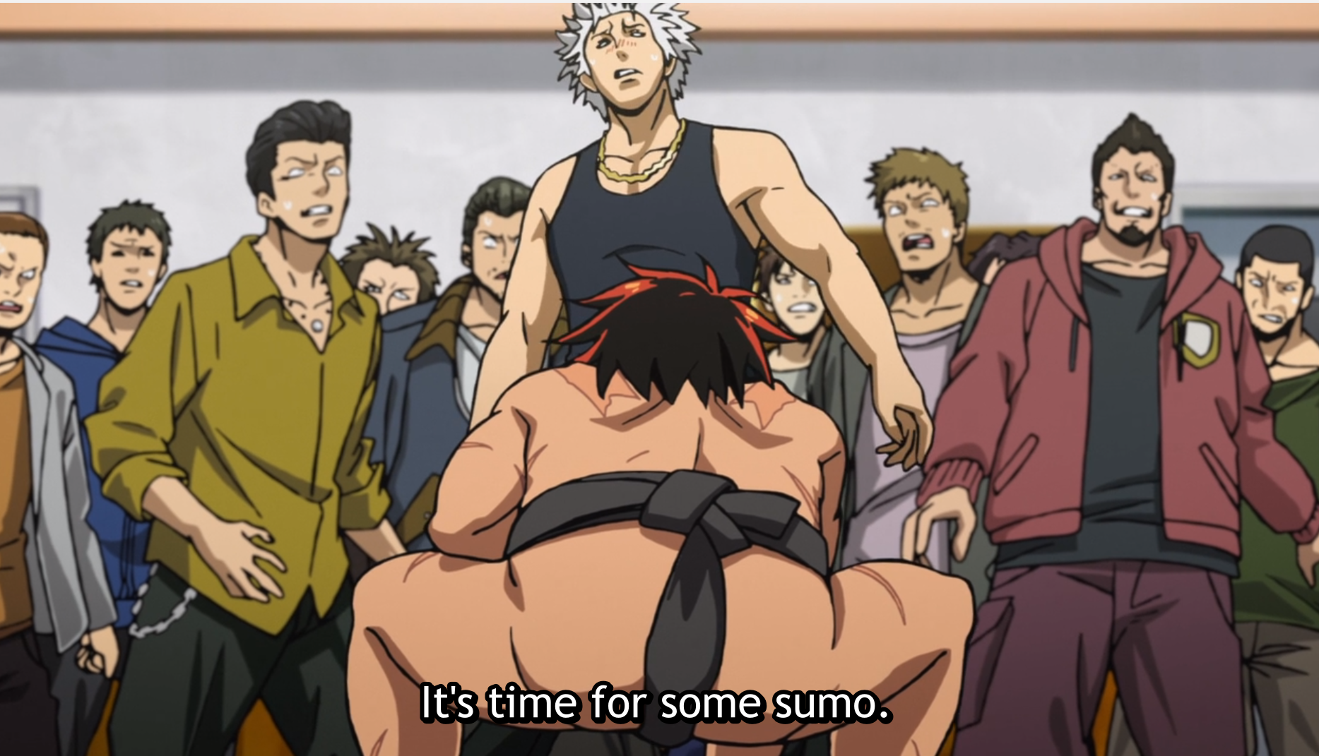 "A young man wearing a sumo loincloth shown from behind, crouching down. In front of him are a group of thugs looking freaked out. Subtitles read ""It's time for some sumo."""