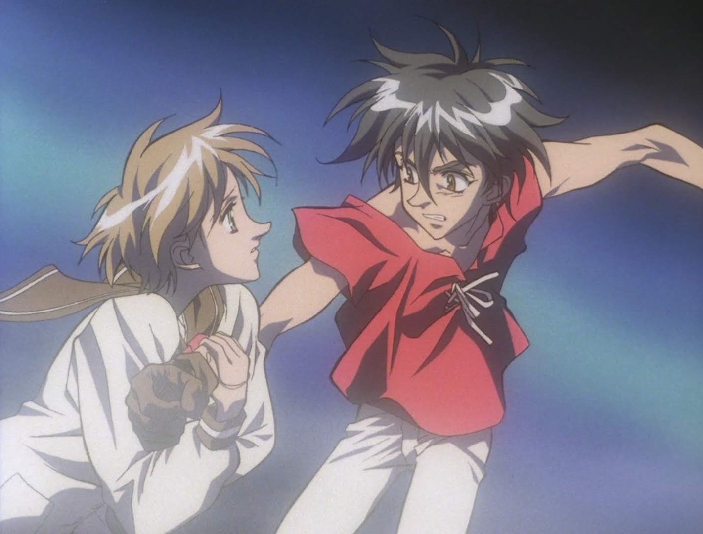 a short-haired girl holds on to a dark haired boy's arm to prevent him from striking out