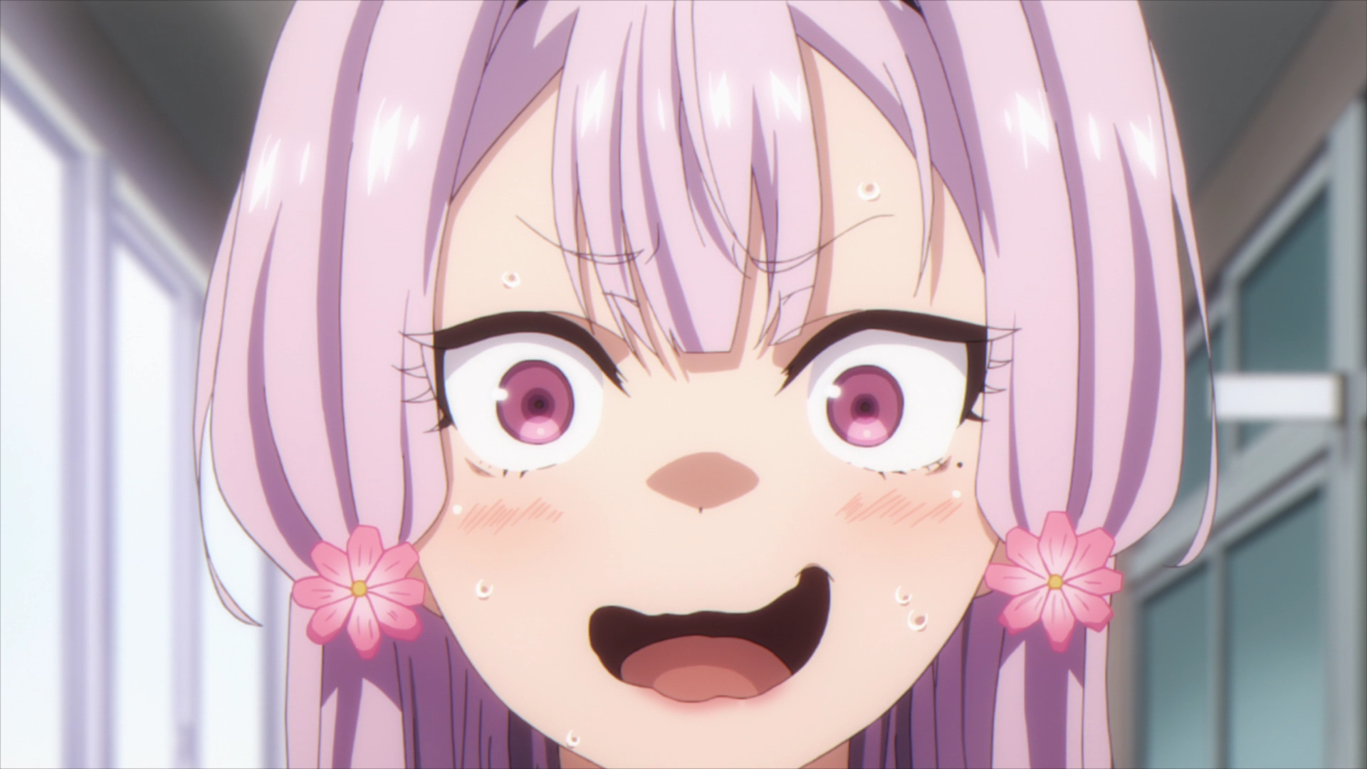 closeup of a girl with pink hair smiling nervously