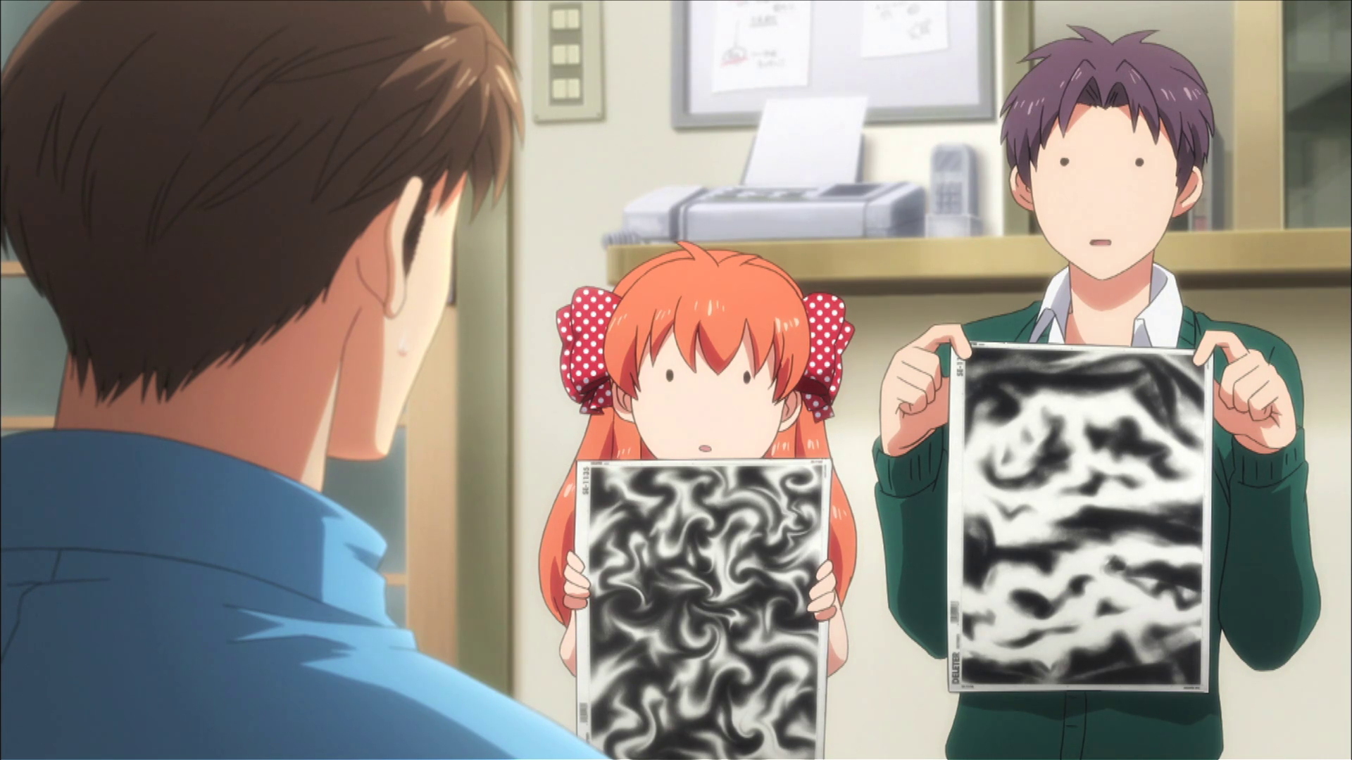 Two characters from Nozaki-kun holding up abstract ink paintings for approval