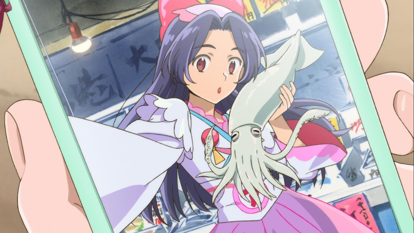 Kazuki from SARAZANMAI in idol dress, taking a selfie with a squid
